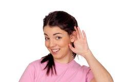 Chica joven bonita que toca su oído Imágenes de archivo libres de regalías