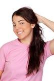 Chica joven bonita que toca su pelo Imágenes de archivo libres de regalías
