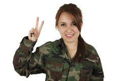 Chica joven bonita vestida en militares verdes Fotos de archivo libres de regalías