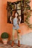 Chica joven cerca de la ventana Fotos de archivo libres de regalías