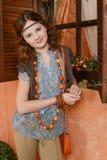 Chica joven cerca de la ventana Fotografía de archivo