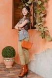 Chica joven cerca de la ventana Foto de archivo libre de regalías