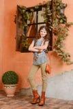 Chica joven cerca de la ventana Imágenes de archivo libres de regalías