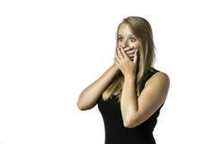 Chica joven chocada en camisa negra Foto de archivo libre de regalías