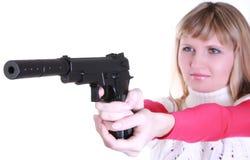 Chica joven con el arma Fotografía de archivo