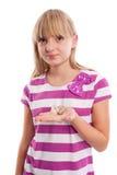 Chica joven con el audífono Imagenes de archivo