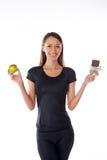 Chica joven con el chocolate y la manzana Foto de archivo libre de regalías