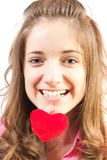 Chica joven con el corazón del juguete Foto de archivo libre de regalías