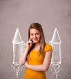 chica joven con el ejemplo del dibujo del cohete del paquete del jet Imagen de archivo
