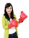 Chica joven con el guante de boxeo Imagen de archivo libre de regalías