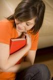 Chica joven con el libro Foto de archivo