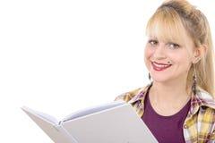 Chica joven con el libro aislado en un fondo blanco Fotos de archivo