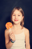 Chica joven con el lollipop Foto de archivo