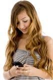 Chica joven con el móvil Imagenes de archivo