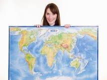 Chica joven con el mapa del mundo fotos de archivo