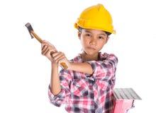 Chica joven con el martillo III Imágenes de archivo libres de regalías