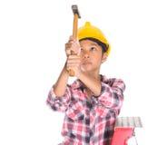 Chica joven con el martillo IV Imagenes de archivo