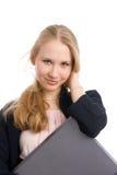 Chica joven con el ordenador portátil Foto de archivo libre de regalías