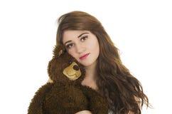 Chica joven con el oso del peluche Imágenes de archivo libres de regalías