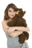 Chica joven con el oso del peluche Foto de archivo libre de regalías