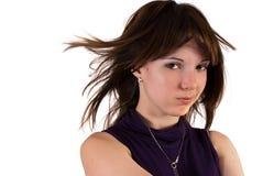 Chica joven con el pelo soplado viento Foto de archivo libre de regalías