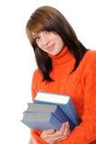 Chica joven con el pelo y el libro largos imagenes de archivo