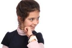 Chica joven con el reloj Foto de archivo libre de regalías
