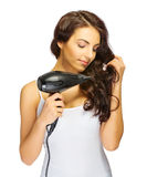 Chica joven con el secador de pelo Fotos de archivo