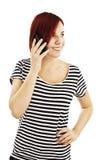 Chica joven con el teléfono Imágenes de archivo libres de regalías