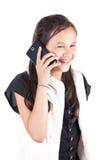 Chica joven con el teléfono elegante Fotografía de archivo libre de regalías