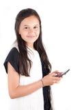 Chica joven con el teléfono elegante Imagen de archivo libre de regalías