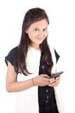 Chica joven con el teléfono elegante Fotos de archivo