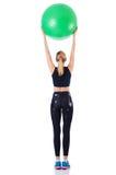 Chica joven con la bola suiza Fotos de archivo