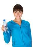 Chica joven con la botella de agua imagenes de archivo