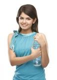 Chica joven con la botella de agua Fotos de archivo