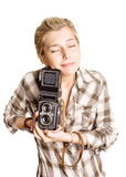 Chica joven con la cámara Imagenes de archivo