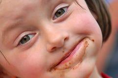 Chica joven con la cara sucia Fotografía de archivo