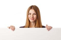 Chica joven con la cartelera Fotos de archivo libres de regalías