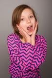 Chica joven con la expresión sorprendida Imagenes de archivo