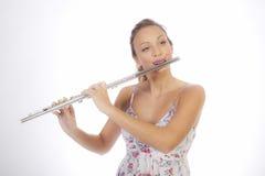 Chica joven con la flauta Foto de archivo