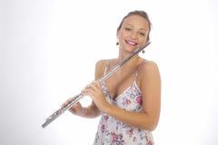 Chica joven con la flauta Imagen de archivo