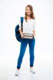 Chica joven con la mochila y los libros Fotos de archivo libres de regalías