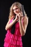 Chica joven con la pistola Imagen de archivo libre de regalías