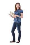 Chica joven con la sonrisa de los libros Imagenes de archivo