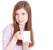 Chica joven con la taza con café Foto de archivo