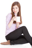Chica joven con la taza con café Imagenes de archivo