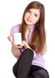 Chica joven con la taza con café Foto de archivo libre de regalías