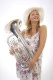 Chica joven con la trompeta Foto de archivo libre de regalías
