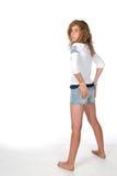 Chica joven con las manos en caderas Fotografía de archivo