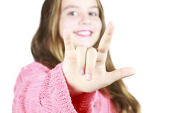 Chica joven con lenguaje de signos Imagen de archivo libre de regalías